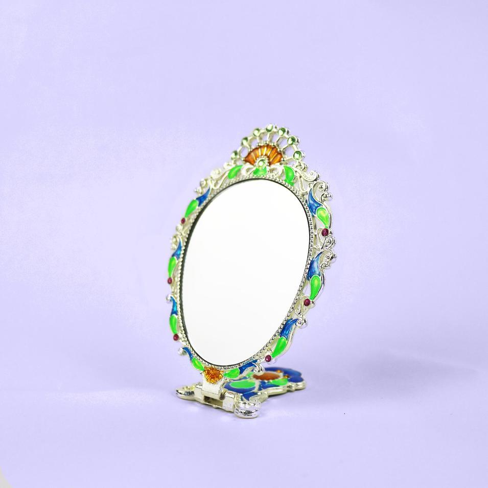 European vintage silver peacock mirror