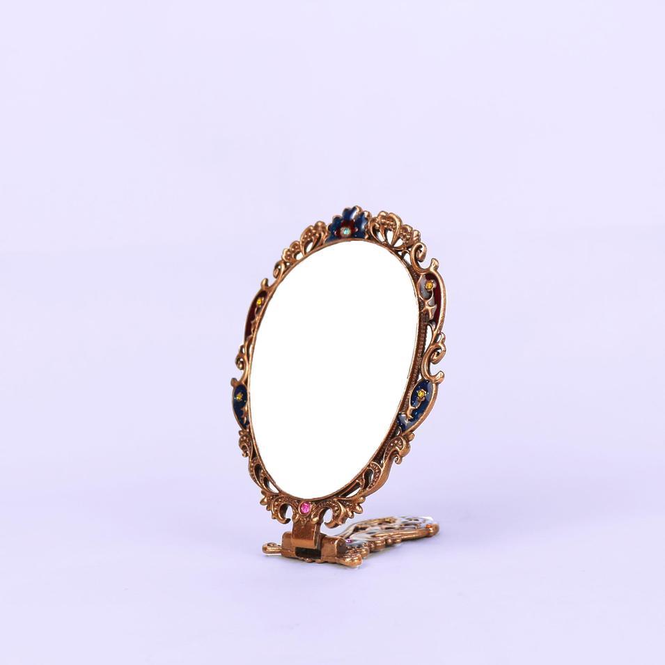 European vintage bronzed butterfly mirror