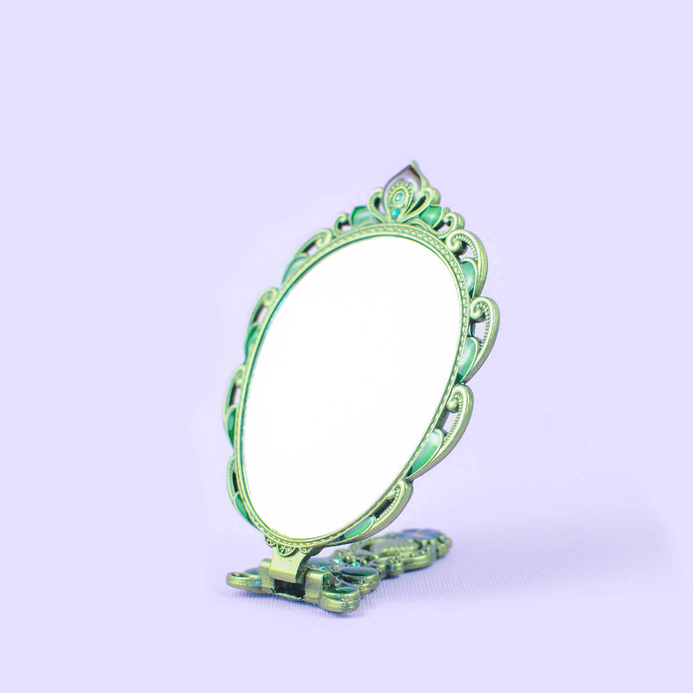 Ancient peacock folding mirror