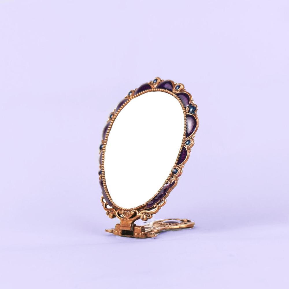 European vintage golden peacock mirror